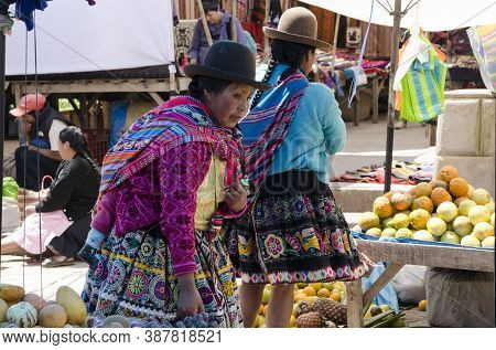 Pisac, Peru- September 27, 2015: Portrait Of A Local Eldery Woman Dressed With Traditional Clothes A