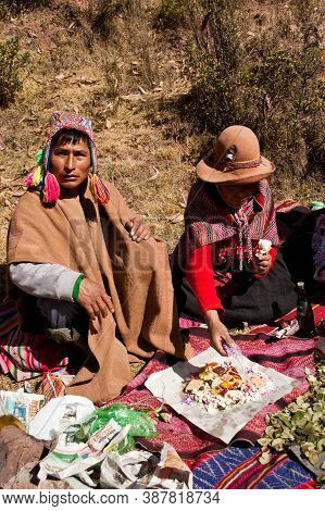 Sacred Valley, Peru- August 31, 2011: Man And Woman Dressed With Traditional Clothes Making An Ances