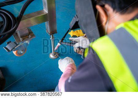 Worker Welding Aluminum Construction A  Piece Of Conveyer