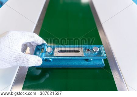 Close Up Of Hand Mechanic Technician Worker Use A Water Level Meter Working And Assemble The Product