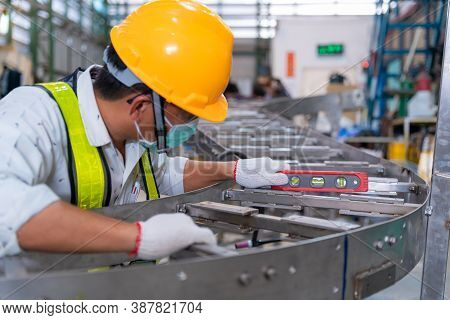 Asian Man Mechanic Wearing Protective Mask To Protect Against Covid-19,male Technician Worker Use A