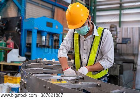 Asian Man Mechanic Wearing Protective Mask To Protect Against Covid-19,male Technician Worker Workin