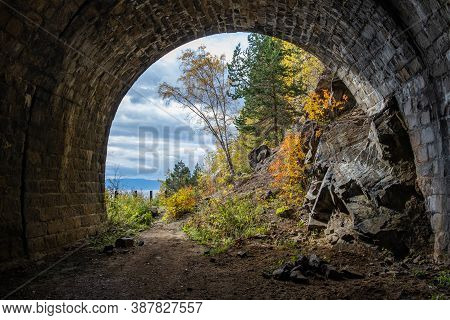 A Gorgeous View From The Tunnel Of The Circum-baikal Railway On A Bright Autumn Landscape On The Sho