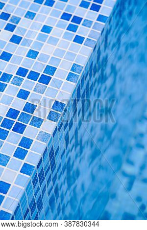 Background Steps With Blue Mosaic Tiles Of A Pool By The Water