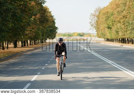 Road Cyclist Exercising On A Gravel Bike. Bicycle Training Outdoors, Modern Looking Bike And Sportsm