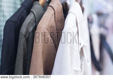 Selective Focus Some Used Leather Clothes Hanging On A Rack In A Shop.