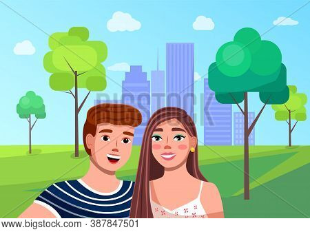Happy Young Couple Make A Selfie At City Park Background, With Buildings At Horizon. People Travelin