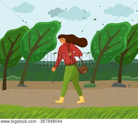 Windy Weather, Woman Walking In Park Through Strong Wind, Green Trees Bend, Leaves Flying In Air, Yo