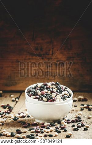 Speckled Beans In White China Bowls On An Old Wooden Background, Selective Focus