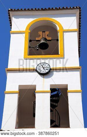 Church Bell And Clock Tower, Benahavis, Costa Del Sol, Malaga Province, Andalucia, Spain, Europe.