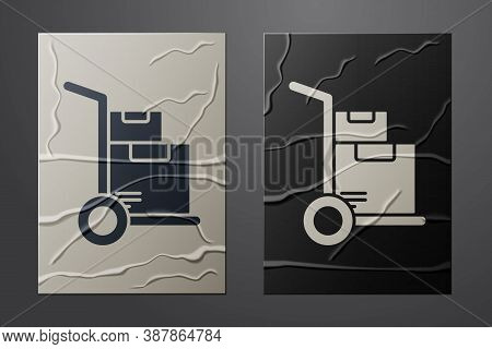 White Hand Truck And Boxes Icon Isolated On Crumpled Paper Background. Dolly Symbol. Paper Art Style