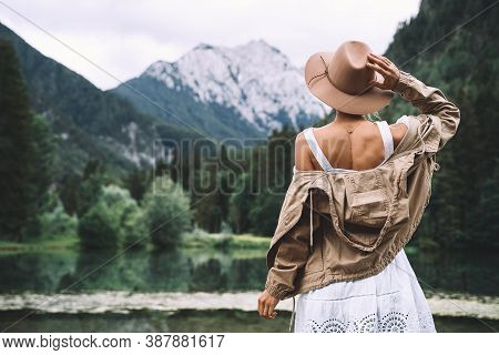 Young Girl Enjoying Beauty Of Nature Looking At Mountain Lake In Jezersko. Adventure Travel In Slove