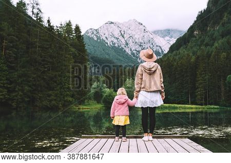 Mother And Daughter Together On Nature. Family Outdoor.