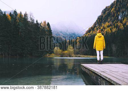 Woman Looking At Mountain Lake In Slovenia. Travel Europe.