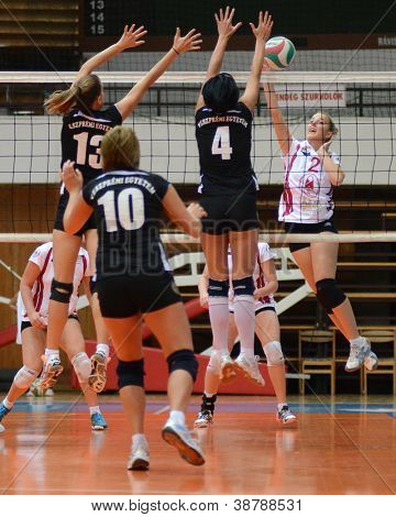 KAPOSVAR, HUNGARY - OCTOBER 7: Zsanett Pinter (R) in action at the Hungarian I. League volleyball game Kaposvar (white) vs Veszprem (black), october 7, 2012 in Kaposvar, Hungary.