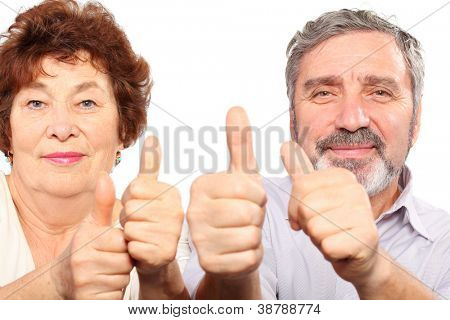 smiling senior couple show thumb, good gesture, isolated
