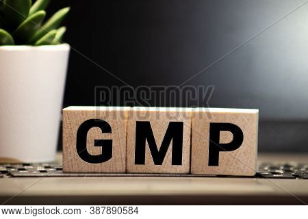 Gmp Word Made With Wood Building Blocks.