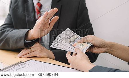 Businessman Refusing Money In The Envelope To Agreement Contract, Bribe And Corruption Concept