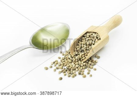 Heap Of Dried Organic Hemp Seeds Or Cannabis Plant Seeds With Hemp Seed Oil In Spoon Isolated On Whi