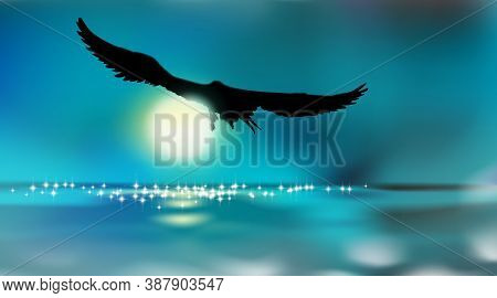 Silhouette Of An Eagle, Flying Over The Water By Moonlight, Art Background. Full Moon Over Surface R