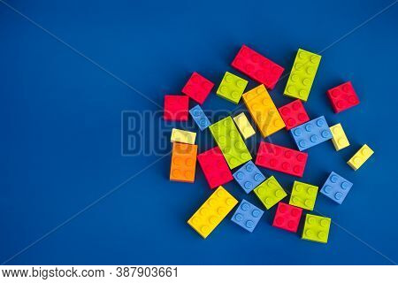 Tambov, Russian Federation - August 26, 2020 Heap Of Lego Blocks Against Blue Background.