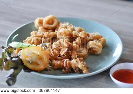 Calamari Or Fried Squid With Vegetable And Sauce