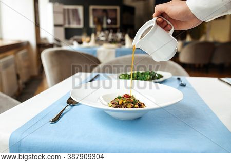 Pouring Broth In A Plate With Spanish Traditional Oxtail Soup