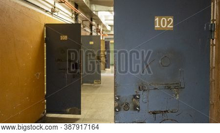 Prison's Windows Of Metal Door Protect Prisoner From Inside To Escape. Food Channel Through Prison C