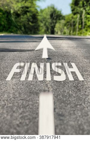 Conceptual Image Of Road With The Word Finish. Asphalt Road With Road Markings And Finish Word. Dire