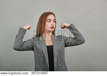 Feels Proud Have Strength, Shows Great Power, Raises Arms To Show Muscles Confident In Victory, Look