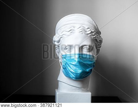 Plaster Copy Of The Head Of The Ancient Statue Of Diana On A Light Textured Background. The Face Of