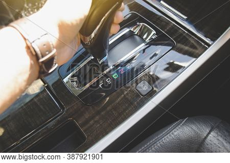 The Driver's Hand Moved The Gear Selector To The Drive (d) Mode Of The Automatic Transmission In The