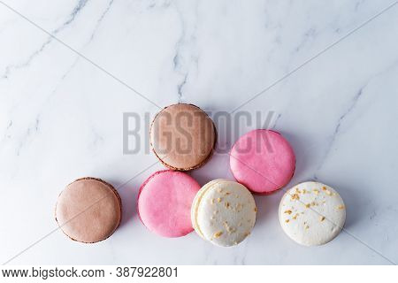 Fresh Sweet Multicoloured Macarons On A Background
