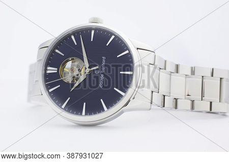Geneve, Switzerland 01.10.2020 - Claude Bernard Man Swiss Made Mechanical Watch Metal Bracelet Isola