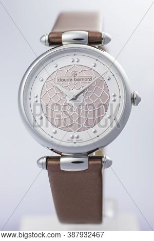 Geneve, Switzerland 01.10.2020 - Claude Bernard Swiss Made Watch Leather Strap Isolated. Stainless S