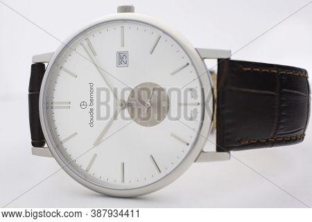 Geneve, Switzerland 01.10.2020 - Claude Bernard Man Swiss Made Watch White Dial Leather Strap Isolat