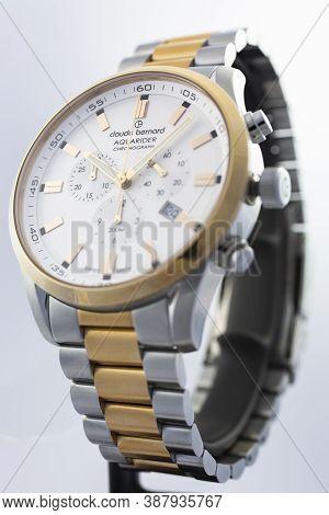 Geneve, Switzerland 01.10.2020 - Claude Bernard Man Swiss Made Watch Gold Pvd Coating White Dial Met