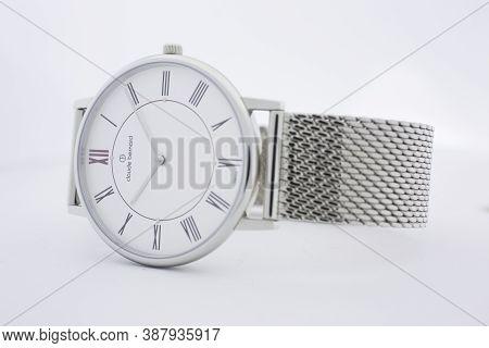 Geneve, Switzerland 01.10.2020 - Claude Bernard Swiss Made Watch White Dial Metal Bracelet Isolated.