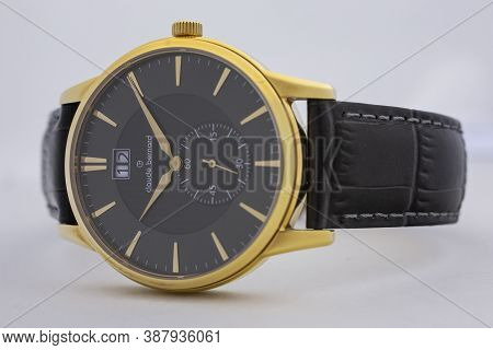 Geneve, Switzerland 01.10.2020 - Claude Bernard Man Swiss Made Watch Gold Pvd Coating Black Dial Lea
