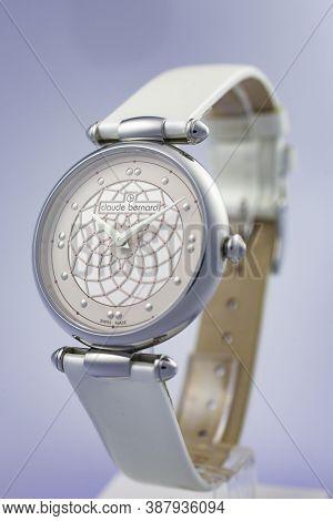 Geneve, Switzerland 01.10.2020 - Claude Bernard Woman Swiss Made Watch Leather Strap Isolated. Swiss