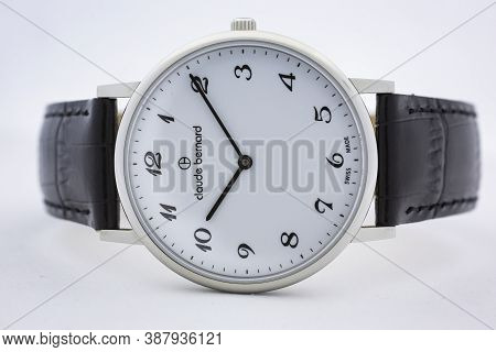 Geneve, Switzerland 01.10.2020 - Claude Bernard Swiss Made Watch White Dial Leather Strap Isolated.