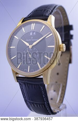 Geneve, Switzerland 01.10.2020 - Claude Bernard Swiss Made Watch Gold Pvd Coating Leather Strap Date