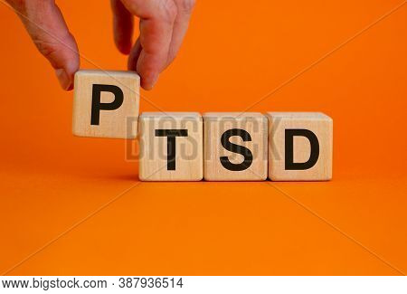 Concept Words 'ptsd, Post-traumatic Stress Disorder' On Cubes On A Beautiful Orange Background. Male
