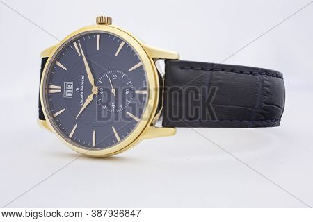 Geneve, Switzerland 01.10.2020 - Claude Bernard Man Swiss Made Watch Gold Pvd Coating Blue Dial Leat
