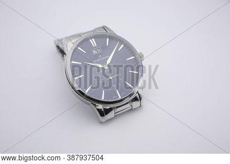 Geneve, Switzerland 01.10.2020 - Claude Bernard Swiss Made Watch Isolated Stainless Steel Case. Swis
