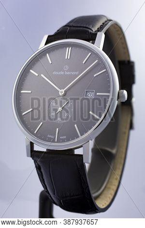 Geneve, Switzerland 01.10.2020 - Claude Bernard Man Swiss Made Watch Leather Strap Isolated. Date In