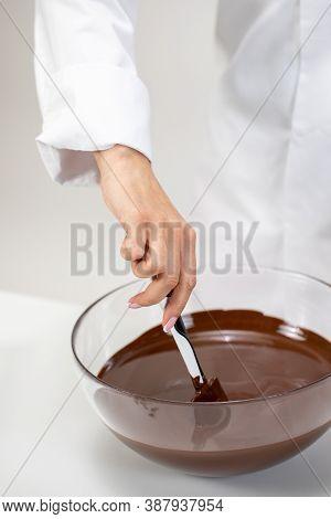 Closeup Female Chef Stirring Dark Melted Chocolate Isolated On White Background. Chocolatier Make Or