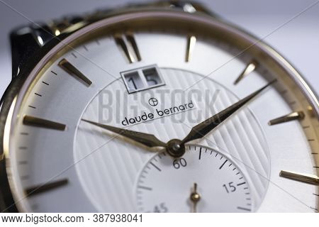 Geneve, Switzerland 01.10.2020 - Claude Bernard Man Swiss Made Watch Gold Pvd Coating White Dial Clo