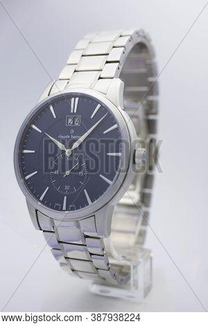 Geneve, Switzerland 01.10.2020 - Claude Bernard Man Swiss Made Watch Blue Dial Metal Bracelet Isolat