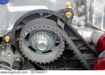 Timing Belt And Camshaft Sprocket In Car Engine.